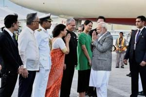 PM Modi visits rice research institute, meets Indian scientists in...