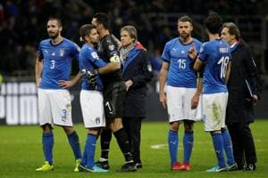 Italy football team members after their loss to Sweden in a 2018 FIFA World Cup playoff in Milan.