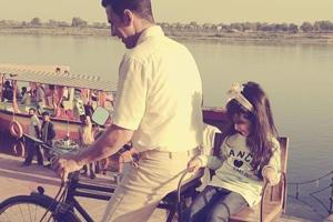 Akshay Kumar takes daughter Nitara on a bike ride on Children's Day....
