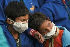Children wearing air pollution masks attend a demonstration to spread awareness on the problem of air pollution, on Children