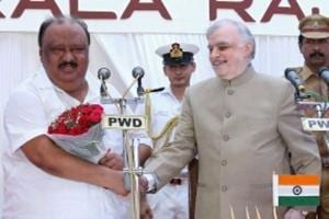 Former Kerala transport minister Thomas Chandy (left) with governor P Sathasivam at his swearing-in ceremony.