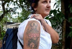 Naomi Coleman shows the tattoo of the Buddha on her arm. (AFP file photo)