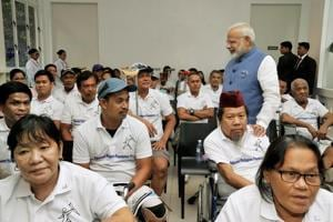 Prime Minister Narendra Modi interacts with the Jaipur Foot beneficiaries, in Manila, Philippines, on Monday.
