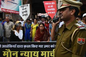 Representatives of various social organisations take out a silent march to protest the recent killing of Ummar in Jaipur on Wednesday.