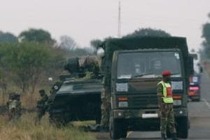Tanks on streets but Zimbabwe army says not a coup, Mugabe is safe:...