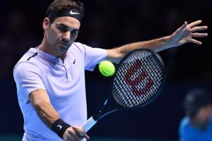 Roger Federer through to ATP Finals tennis semis after win over...