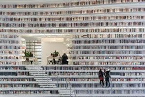 This six-storey futuristic library in China has shelves stacked with...