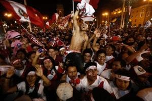 Fans celebrated in Lima after watching Peru beat New Zealand 2-0 in...
