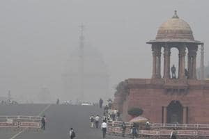 Government department buildings are shrouded by heavy smog in New Delhi on November 16, 2017.