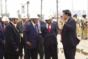 AM Naik talking to National Security Adviser Ajit Doval.