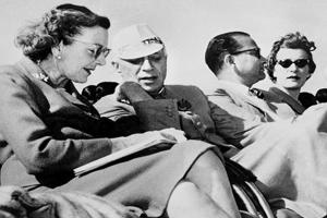 Pandit Jawaharlal Nehru (2L) talks with Lady Mountbatten during a display at the New Delhi Glider Club on 27 February 1959.