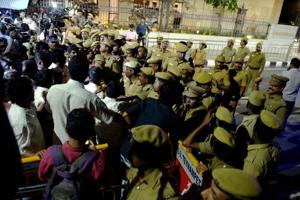 Police and media persons out side the former Tamil Nadu chief minister J Jayalalithaa