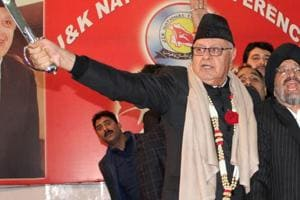 Former Jammu and Kashmir chief minister Farooq Abdullah holds a sword during a programme in Jammu on Saturday.