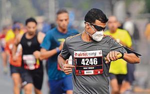 The runners — many of whom were in masks and wore portable air-purifiers — felt the effect of pollution.
