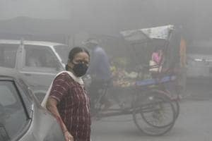 A woman wears a face mask due to smog at Mayur Vihar in New Delhi,  on November 8, 2017. Delhi suffered poor  air quality for a week at the start of November, triggering a political slugfest over who was responsible.
