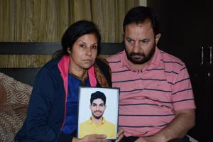 Sweety Bhasin and Sunil Bhasin with a picture of their deceased son, Tanishq Bhasin, at their house in Panchkula.