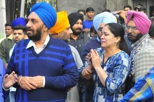 Building owner Inderjit Singh's daughter-in-law wailing. Inderjit was rushed to the hospital following a cardiac arrest after his building collapse.