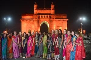 The players participating in the Mumbai Open WTA tennis tournament pose in front of the Gateway of India during a promotional event on Monday.
