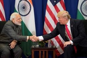 Prime Minister Narendra Modi shakes hands with US President Donald Trump during a bilateral meeting on the sideline of the 31st Association of Southeast Asian Nations (ASEAN) Summit in Manila on November 13. The transformation of the ties between two countries will facilitate India's rise.
