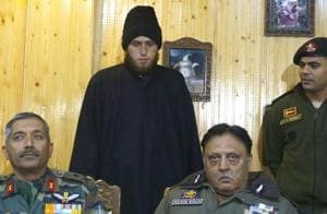 Majid Khan with police officials after his surrender last week.