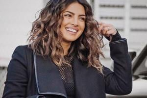 Priyanka Chopra can't stop running hands through her short new hair....