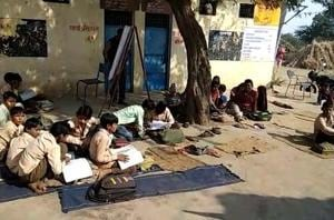 No classrooms, school students forced to study under open sky in Mewat