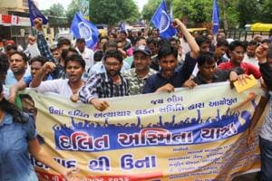Dalits shout slogans during a protest march from Ahmedabad to Una where four from the community were brutally beaten by alleged vigilantes for skinning a dead cow, in Gujarat's Ahmedabad, in August 2016.
