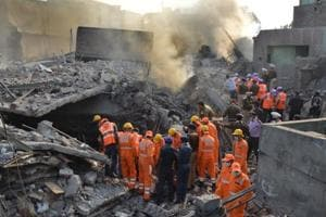 Police, NDRF and Army personnel carrying out the rescue operation after a multi-storey building collapsed in Mushtaq Gunj area near Suffian Chowk, Ludhiana on Monday.