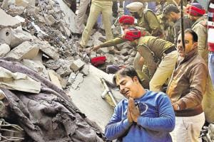 A man prays for safety of those trapped in the debris at the mishap site in Ludhiana.