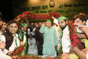RJD chief Lalu Prasad being garlanded by supporters after he was re-elected as party national president at the party