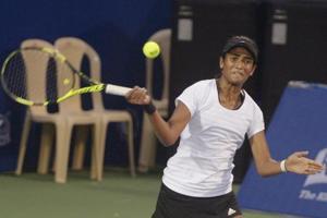 Rutuja Bhosale returns to Israel's Deniz Khazaniuk in the ffirst round of the Mumbai Open WTA tennis tournament on Tuesday.