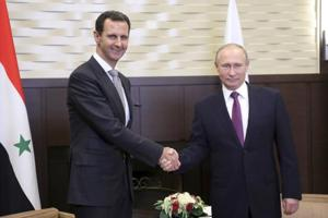 Russia's Putin hails Syria's Assad for fighting terrorists