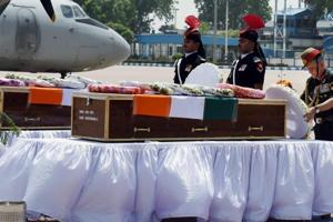 Army chief Gen Bipin Rawat pays homage to soldiers killed in a militant ambush on Jammu-Srinagar national highway, in New Delhi in April 2017.