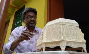 Israr Ahmed, a craftsman, received the President's Award for his fine carvings in 2016. He is among 350 bone craftsmen from Lucknow.