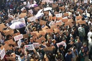 Nagaland government employees  staged  a rally in Kohima on Tuesday seeking withdrawal of cases filed against their colleagues by the National Investigation Agency