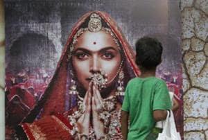 A boy looks at a poster of Bollywood film Padmavati featuring Deepika Padukone in Mumbai.  The film has banned in Gujarat and Madhya Pradesh.