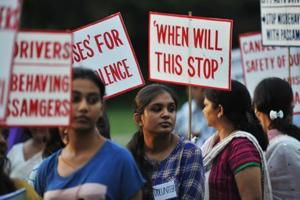 Activists hold placards as they protest against violence and crimes against women on July 26, 2013.