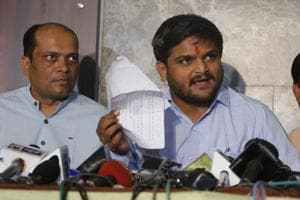 Hardik Patel with Dinesh Bhambaniya (L) addresses a press conference in Ahmedabad on Wednesday.