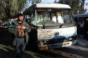 A member of the Afghan security forces stands guard near the site of a suicide attack in Jalalabad on November 23, 2017.