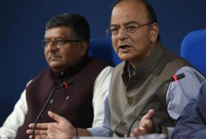 Union finance minister Arun Jaitley and minister of law and justice Ravi Shankar Prasad address a press conference after a cabinet meeting at PIB Conference Hall in New Delhi on Wednesday, November 22, 2017.