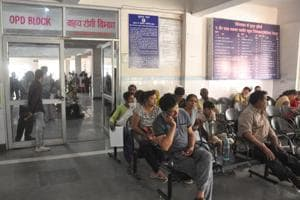 Patients wait for their turn at a government hospital in Dehradun.