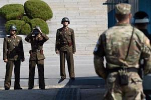 N Korea sacks soldiers after failing to stop defector, South awards...