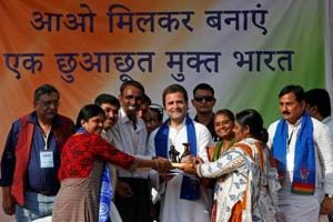 Rahul Gandhi hugs lecturer on listening to her plight during an...