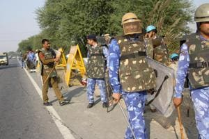 Rohtak,November 25: Sarpanches and other Jat leaders protesting against the AIJASS rally proposed to be held at Jassia village argue with police and administrative officials near rally venue on November 25.