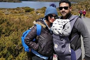 At Cradle Mountain National Park in Tasmania (Australia), while our baby naps peacefully in her carrier.