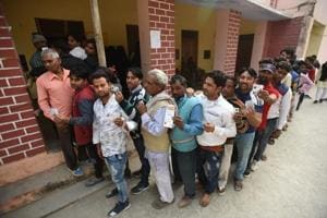 People queue up to vote in Gautam Budh Nagar on Sunday.