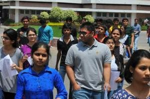 Students moving out of exam centres after appearing in the JEE Mains exam in Indore,  on April 3, 2016. In the past, IITs have refused to allow other agencies to conduct its examinations.