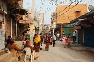 A majority of shops and small business establishments remained shut as the locality witnessed hectic polling activity amid huge police presence.