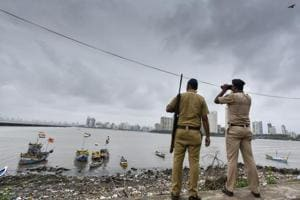 A police commando stands guard by the sea coast at Geeta Nagar, Colaba, after a high alert was issued in Mumbai, on September 23, 2016.