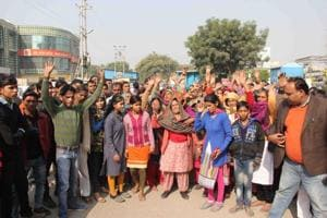 Locals protest outside the high-rise on Monday.